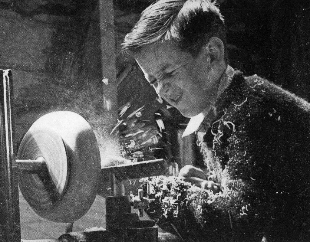 Boy working the lathe, 1940s