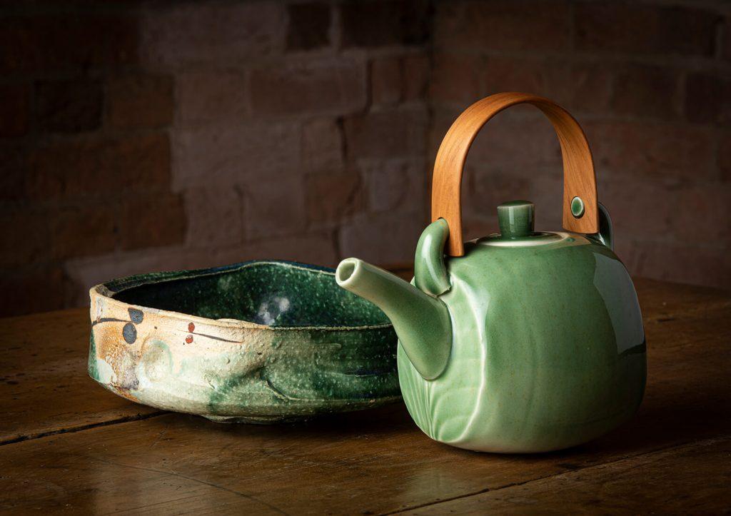 Paul Davis, Dish, stoneware, Oribe glaze, 2006; Chris Weaver, Teapot, porcelain, celadon glaze, 2010. Image, Ashley Mackevicius
